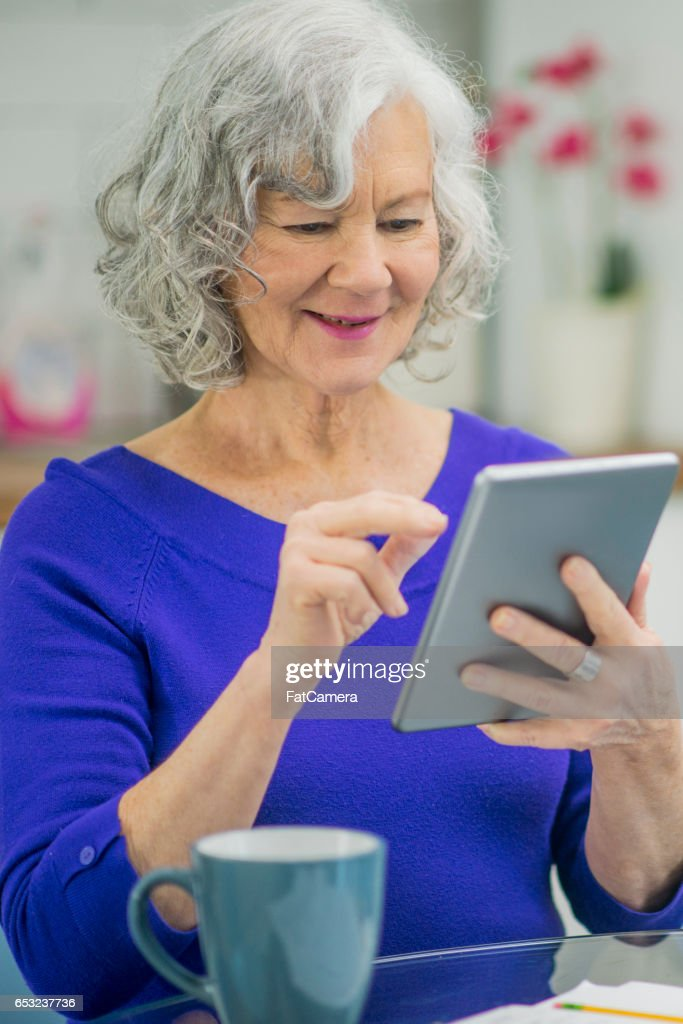 Senior Woman Using a Digital Tablet : Stock Photo