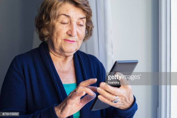 senior woman using digital tablet - candid forum stock pictures, royalty-free photos & images
