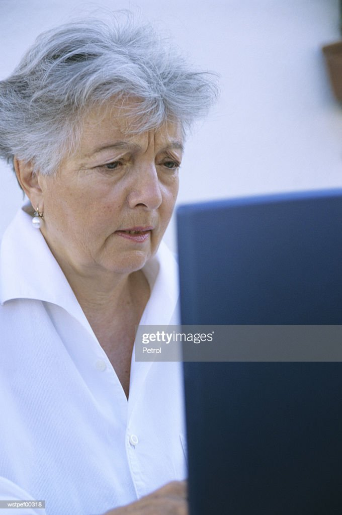 Senior woman using laptop : Stock Photo