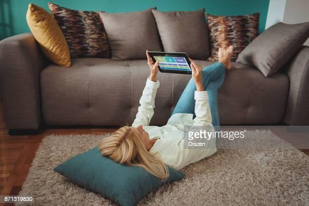 Senior woman using modern technologies at home
