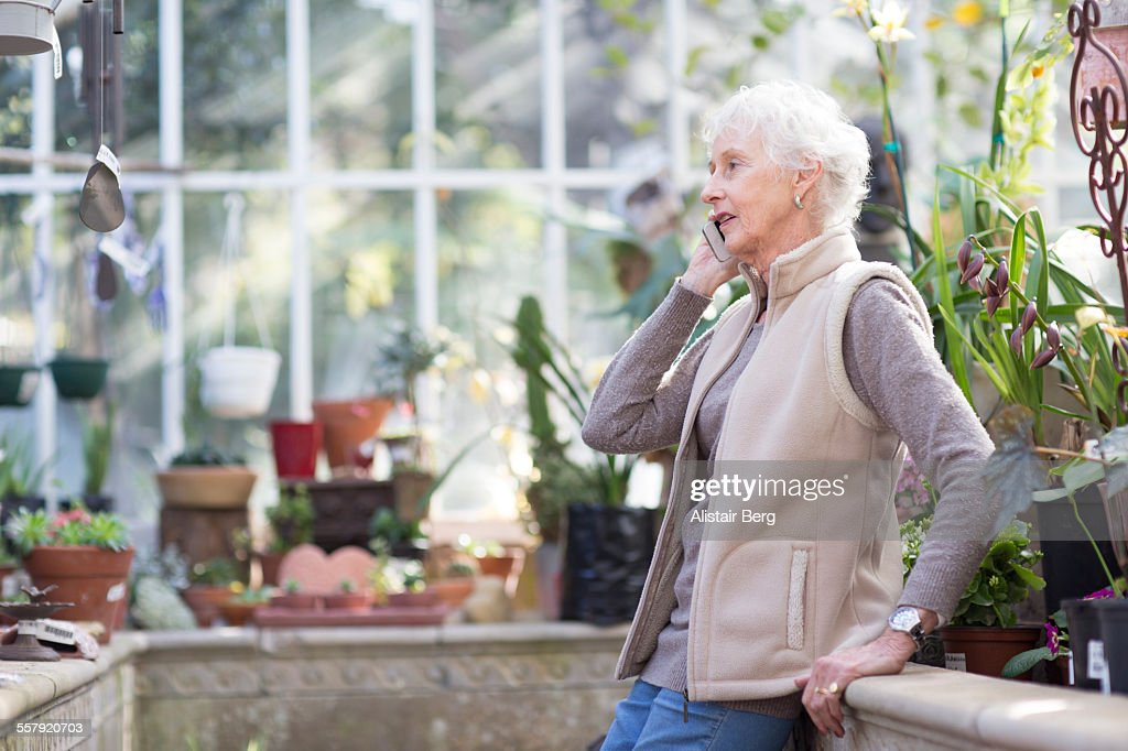 Senior woman using smart phone : Stock Photo
