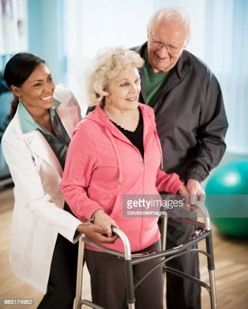 senior woman using walker - assistive technology stock photos and pictures