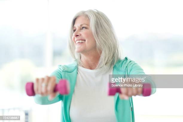 Senior woman using weights