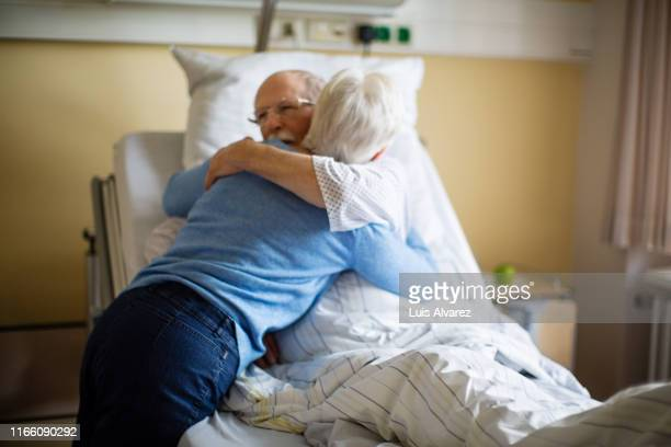 senior woman visiting her husband in hospital - visit stock pictures, royalty-free photos & images