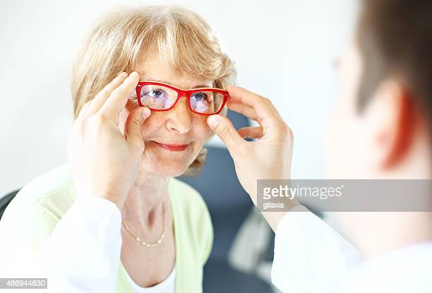 Senior woman visiting optician.