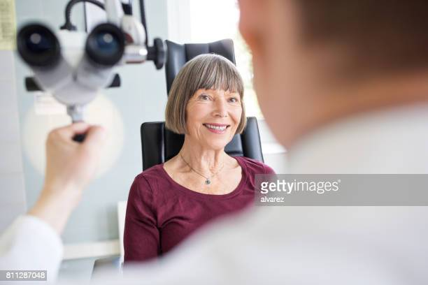 Senior woman visiting otolaryngologist doctor