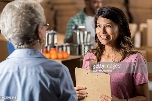 Senior woman volunteers at food bank