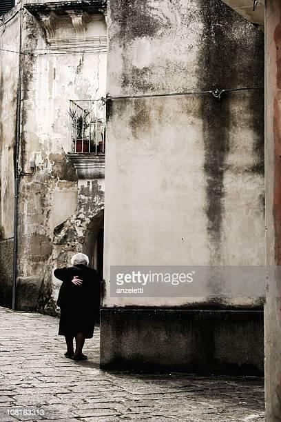 Senior Woman walking in a Sicilian town