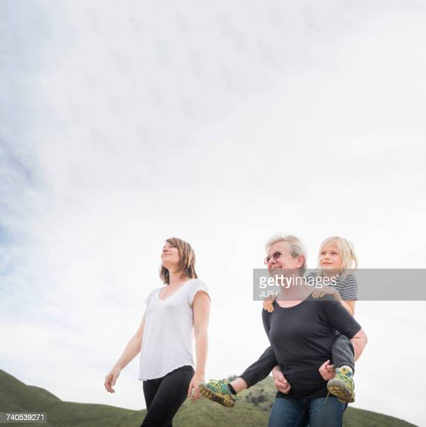 Senior woman walking with daughter and grandson