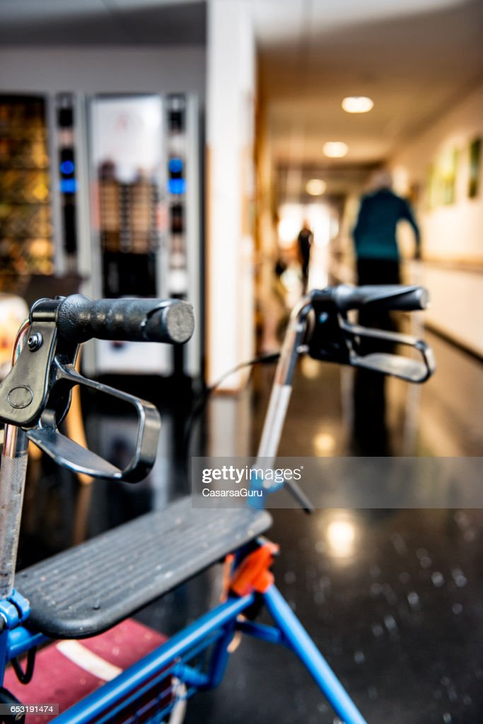 Senior Woman Walking With Mobility Walker In The Retirement Center : Foto stock