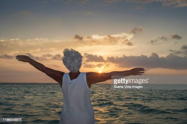 senior woman watching sunset - vilamendhoo stock photos and pictures