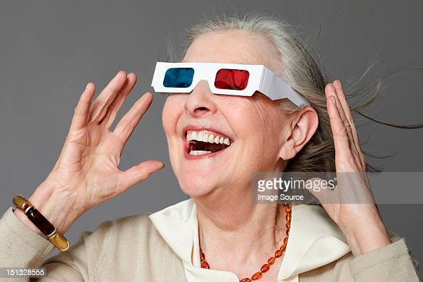 senior woman wearing 3d glasses - redoubtable film stock photos and pictures