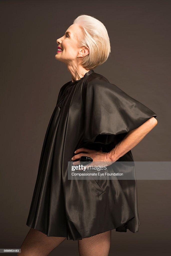 Senior woman wearing black satin dress : Stock Photo