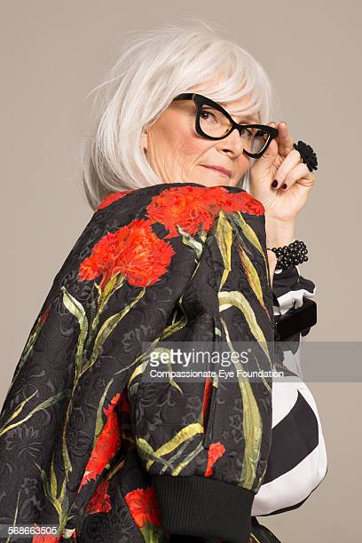 Senior woman wearing glasses and stylish clothes
