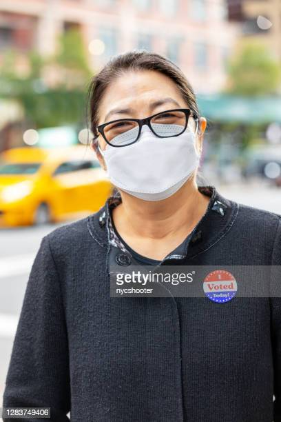 """senior woman wearing """"i voted today"""" sticker - voting stock pictures, royalty-free photos & images"""