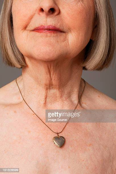 Senior woman wearing pendant