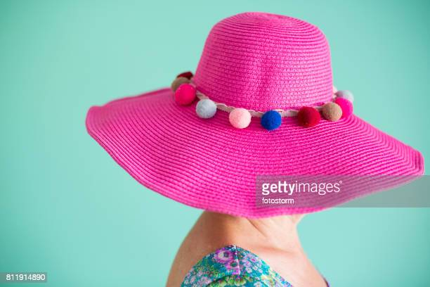 Senior woman wearing pink hat