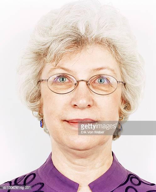 Senior woman wearing spectacles, smiling, portrait, close-up