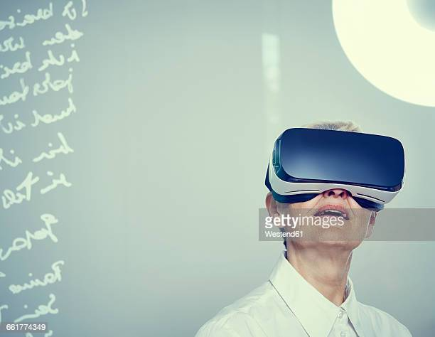 Senior woman wearing Virtual Reality Glasses
