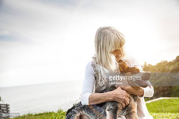 Senior woman with a dog