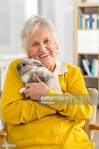 Senior woman with a little rabbit