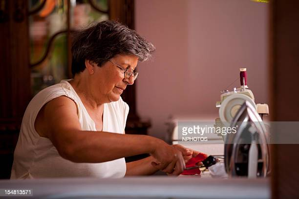 Senior woman with a sewing machine