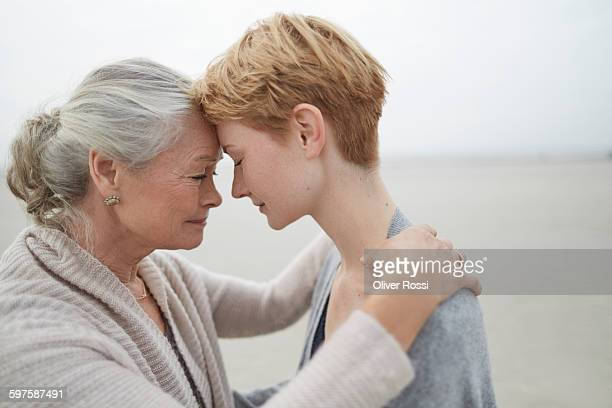 Senior woman with adult daughter face to face