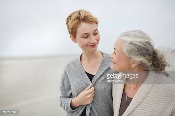 Senior woman with adult daughter on the beach