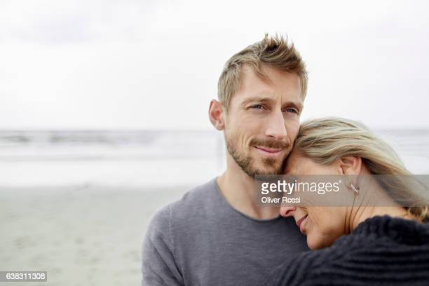 Senior woman with adult son on the beach