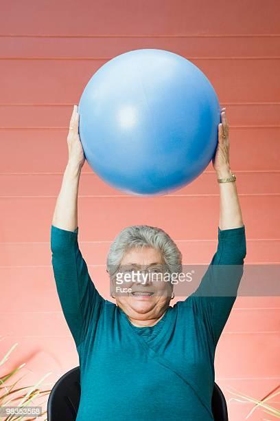 Senior woman with an exercise ball