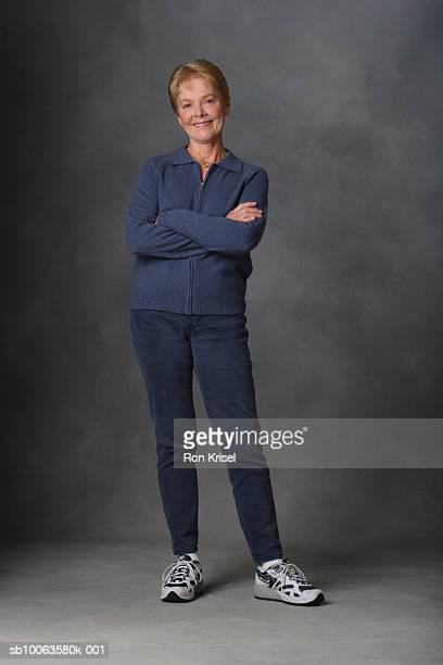 Senior woman with arms folded, portrait