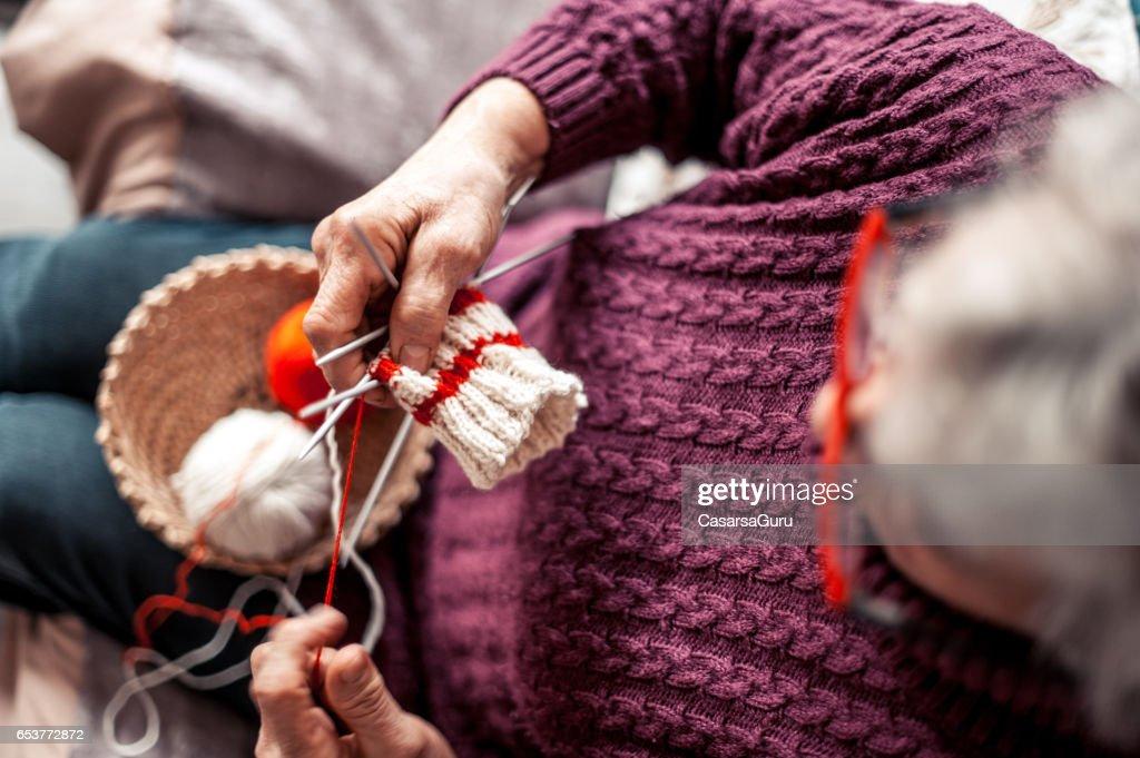 Senior Woman With Arthritic Hands Doing Crochet : Stock Photo