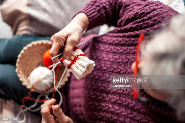 Senior Woman With Arthritic Hands Doing Crochet