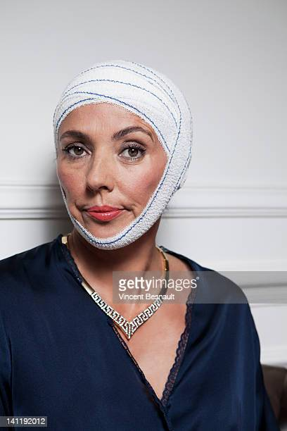 Senior woman with bandages on head