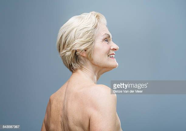 Senior woman with bare shoulders, back view..
