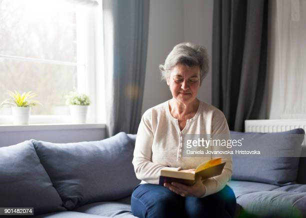 senior woman with bible - residential care stock photos and pictures