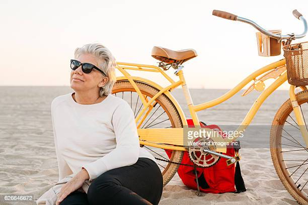 Senior woman with bike