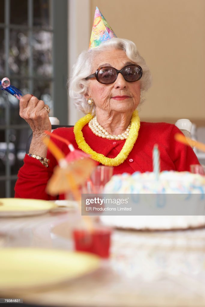 Senior Woman With Birthday Cake Stock Photo Getty Images