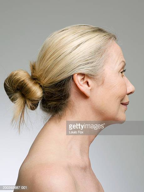 Senior woman with blonde hair in bun, profile
