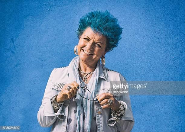 Senior woman with blue hair.