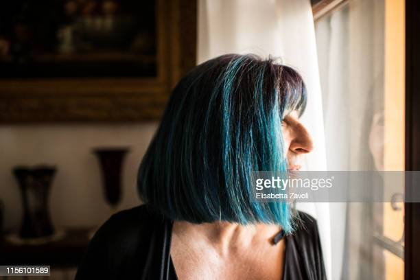 senior woman with blue-dyed hair - blue hair stock pictures, royalty-free photos & images