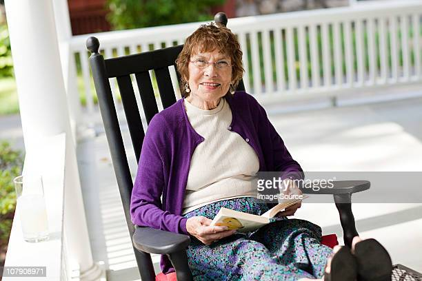 senior woman with book - eine seniorin allein stock-fotos und bilder