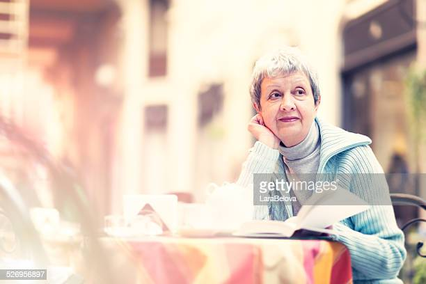 Senior woman with book
