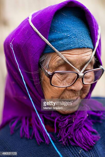 senior woman with broken spectacles - merten snijders stock pictures, royalty-free photos & images