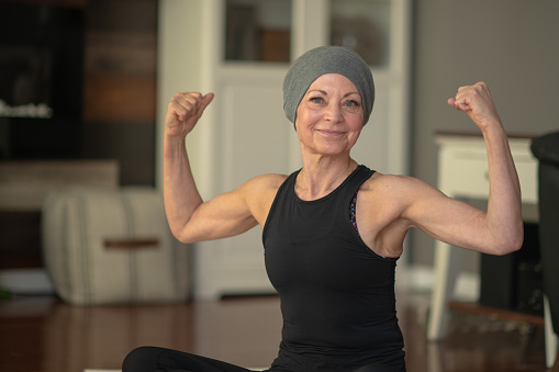 Senior woman with cancer flexing 1149157781