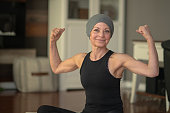 Senior woman with cancer flexing
