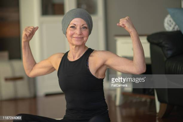 senior woman with cancer flexing - survival stock pictures, royalty-free photos & images