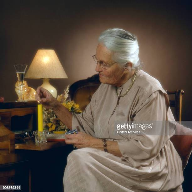 Senior woman with candle 1980s