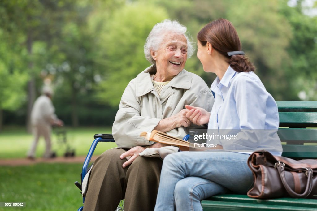 Senior woman with caregiver in the park : Stock Photo