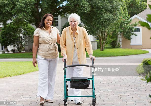 senior woman with caregiver - carers stock photos and pictures